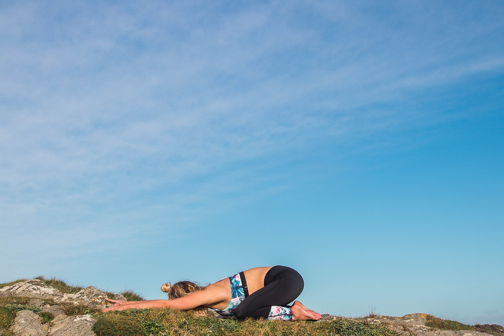 4 yoga poses for back pain, Wild & Free Adventures, yoga teacher Philly Lewis in Cornwall, Island Feather