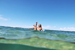 Paddling out over glassy water
