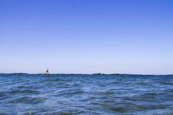Surfing over glassy ocean