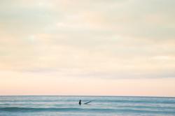 Solo surf stunning sky Cornwall Surf Yoga Retreat Wild Free