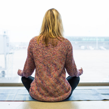 6 Yoga Poses For The Airport