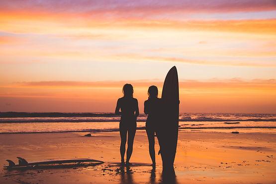 Beautiful girls with a beautiful orange sunset behind
