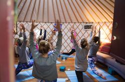 Group yoga in the yoga yurt Cornwall Surf Yoga Retreat Wild Free