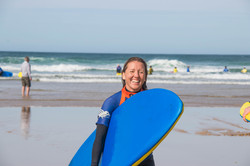 Amanda Bunton post surf smiles Cornwall Surf Yoga Retreat Wild Free