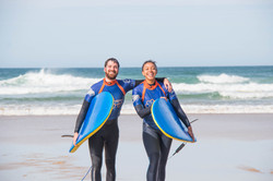 Surfing smiles Cornwall Surf Yoga Retreat Wild Free