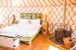 Beautiful double bed in the yurt Cornwall Surf Yoga Retreat Wild Free