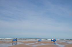 Surfing in Mawgan Porth Cornwall Surf Yoga Retreat Wild Free