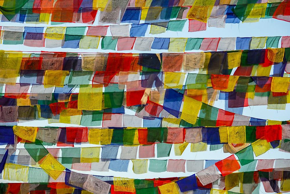 ahimsa, practice of nonviolence, yoga, prayer flags