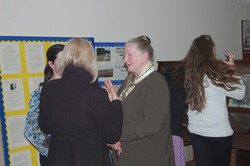 Audience discuss lecture