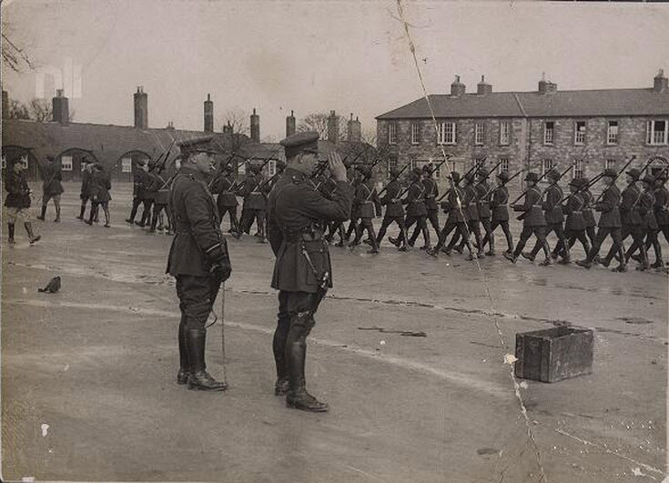 Gen MacEoin taking the salute as Free State Soldiers march into Athlone Barracks