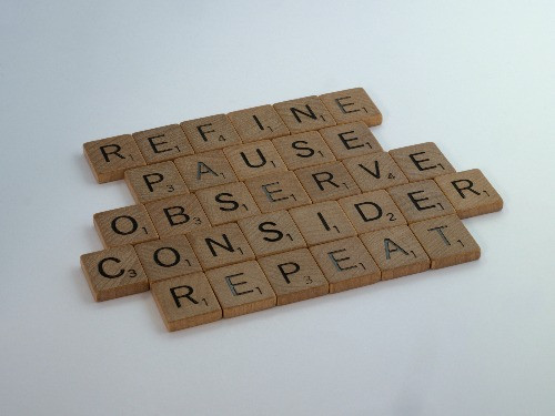 scrabble tiles arranged in five words. Refine, pause, observe, consider, repeat