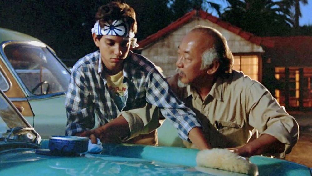 Mr Miyagi teaching Daniel to wax on, wax off