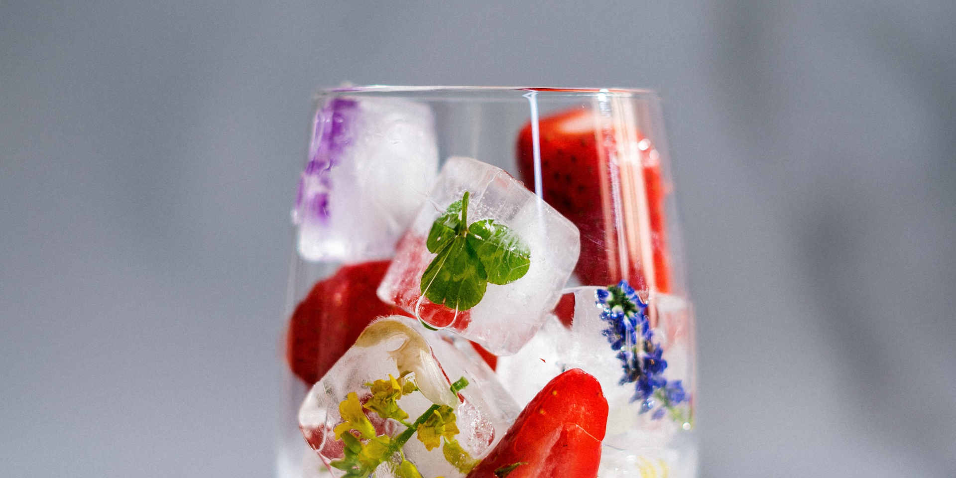 clear-drinking-glass-with-strawberry-jui