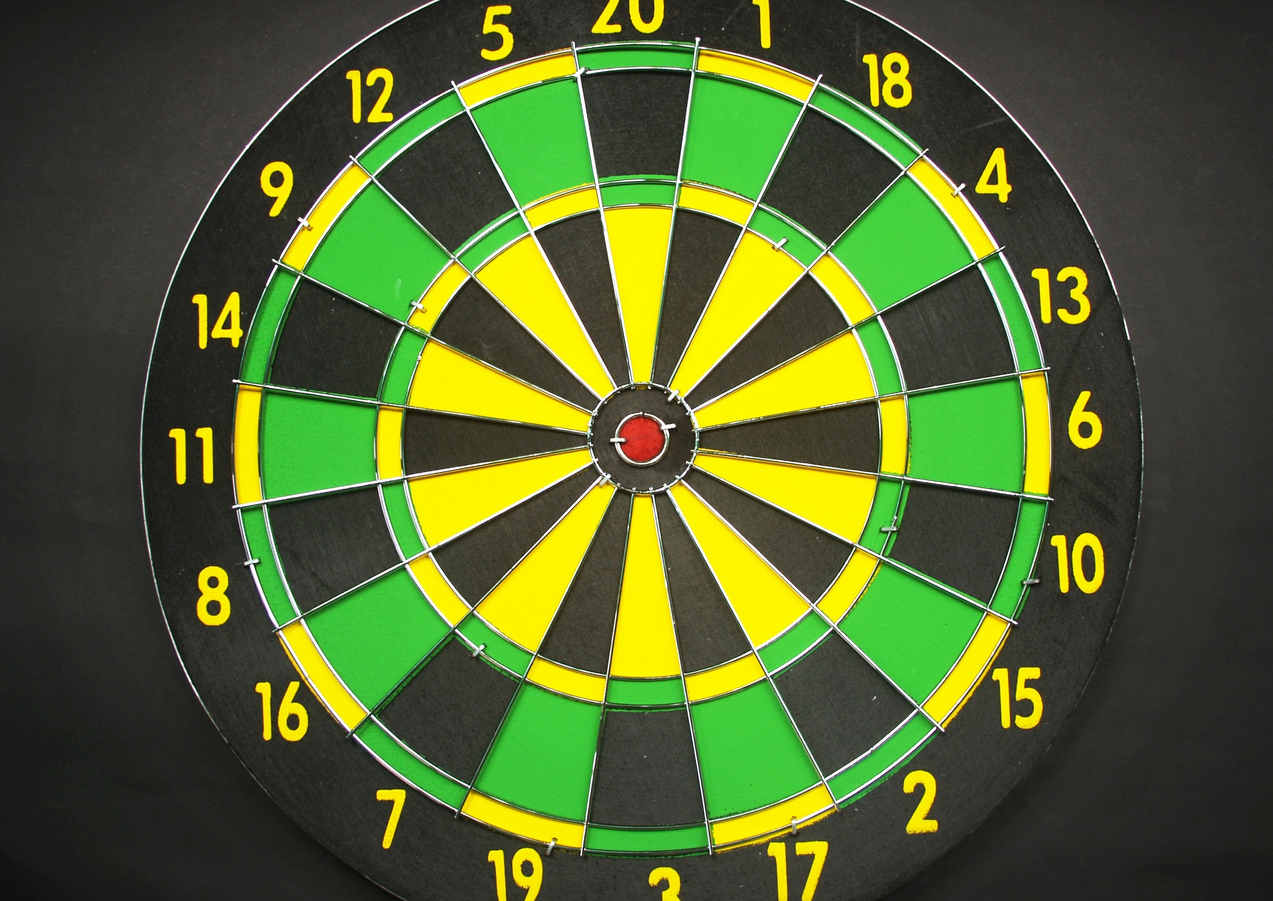 green-yellow-and-black-round-dart-board-