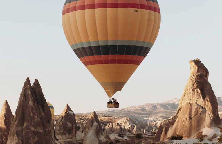 hot-air-balloon-on-mid-air-above-rock-fo