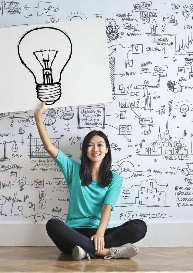 woman-draw-a-light-bulb-in-white-board-3