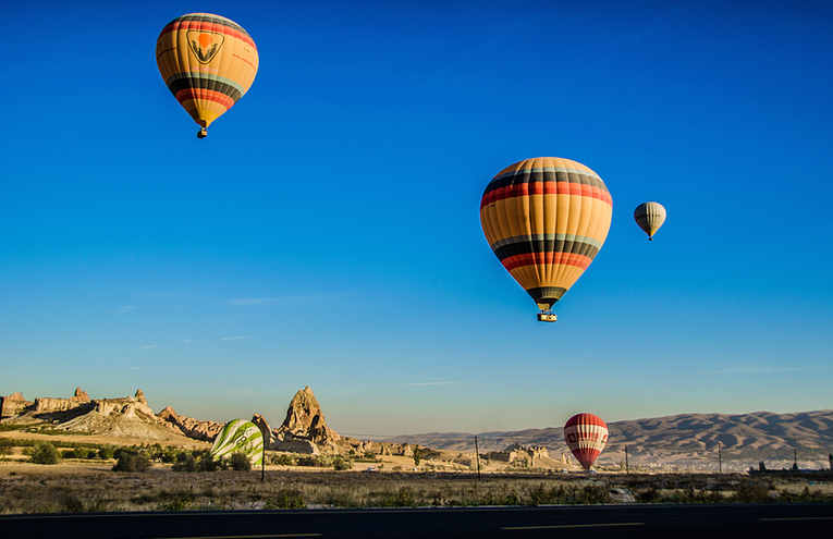 four-beige-hot-air-balloons-flying-61860