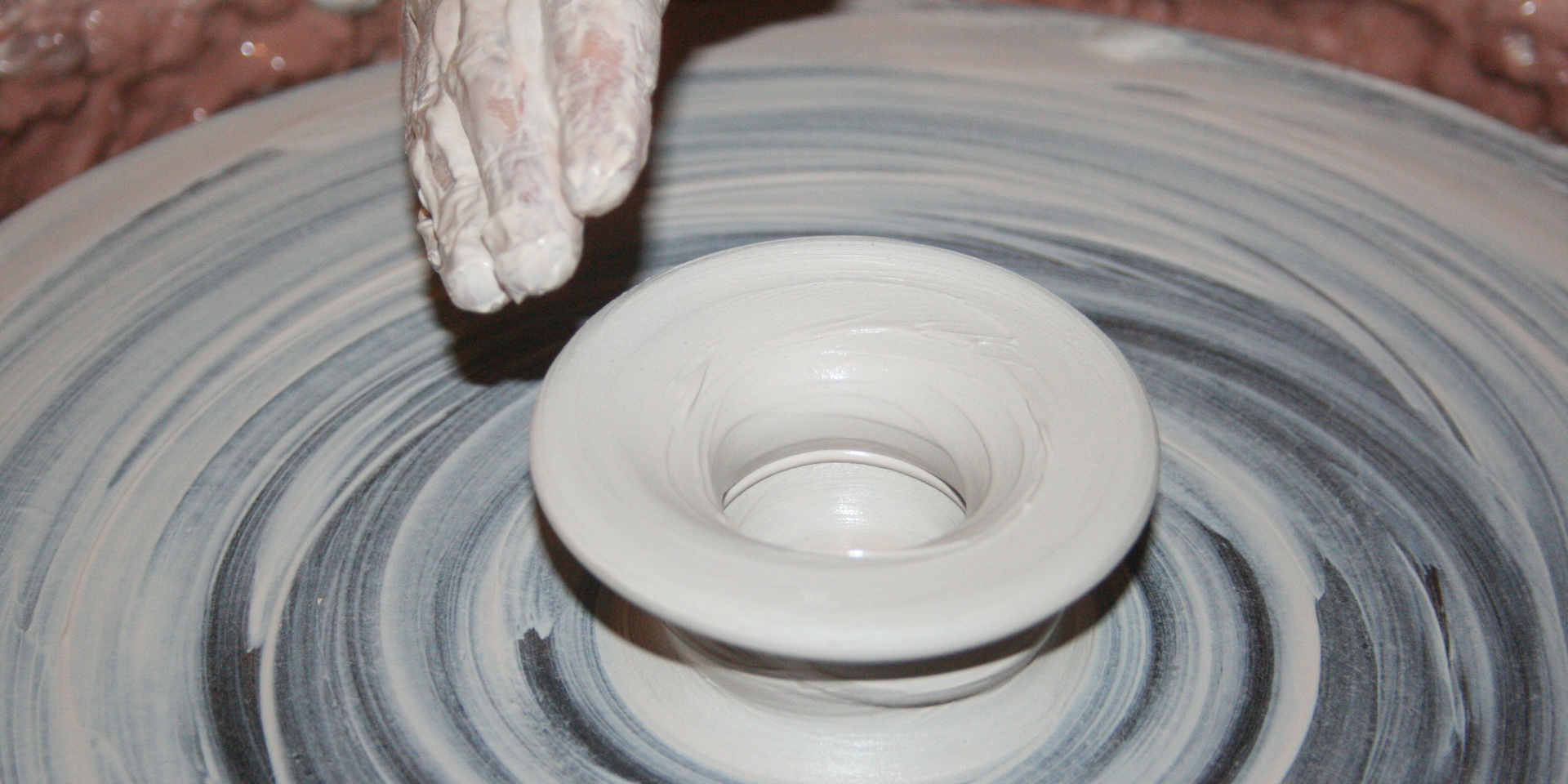 person-making-clay-pot-162574.jpg