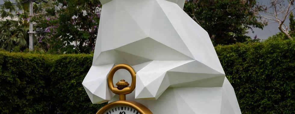 white-rabbit-holding-gold-frame-pocket-w