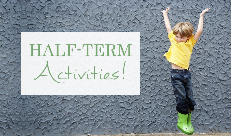 February Half Term Activities - young boy jumping with joy wearing wellies and a yellow t shirt