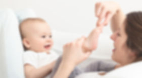 surrogate mom touching her baby's toes