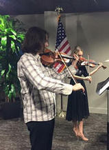 Violin duo playing for a corporate event