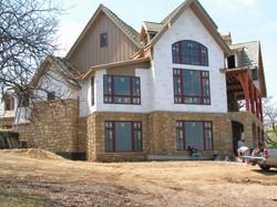 Stone & Decorative Timber Frame Home