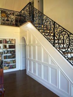 White Wood Panel & Iron Staircase