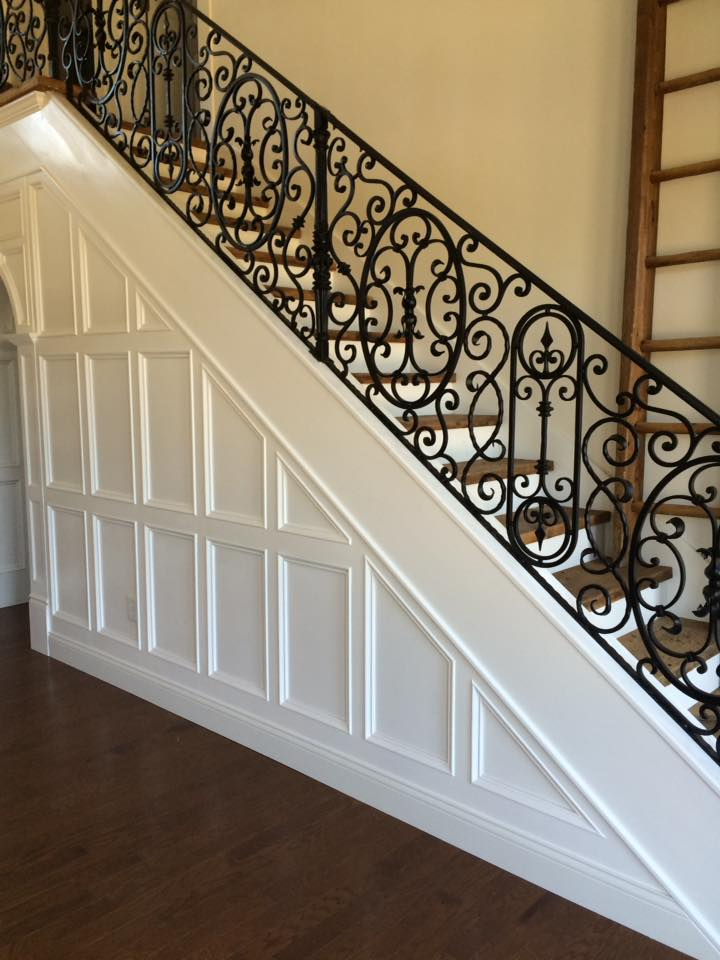 White Wood Panel & Iron Staircase