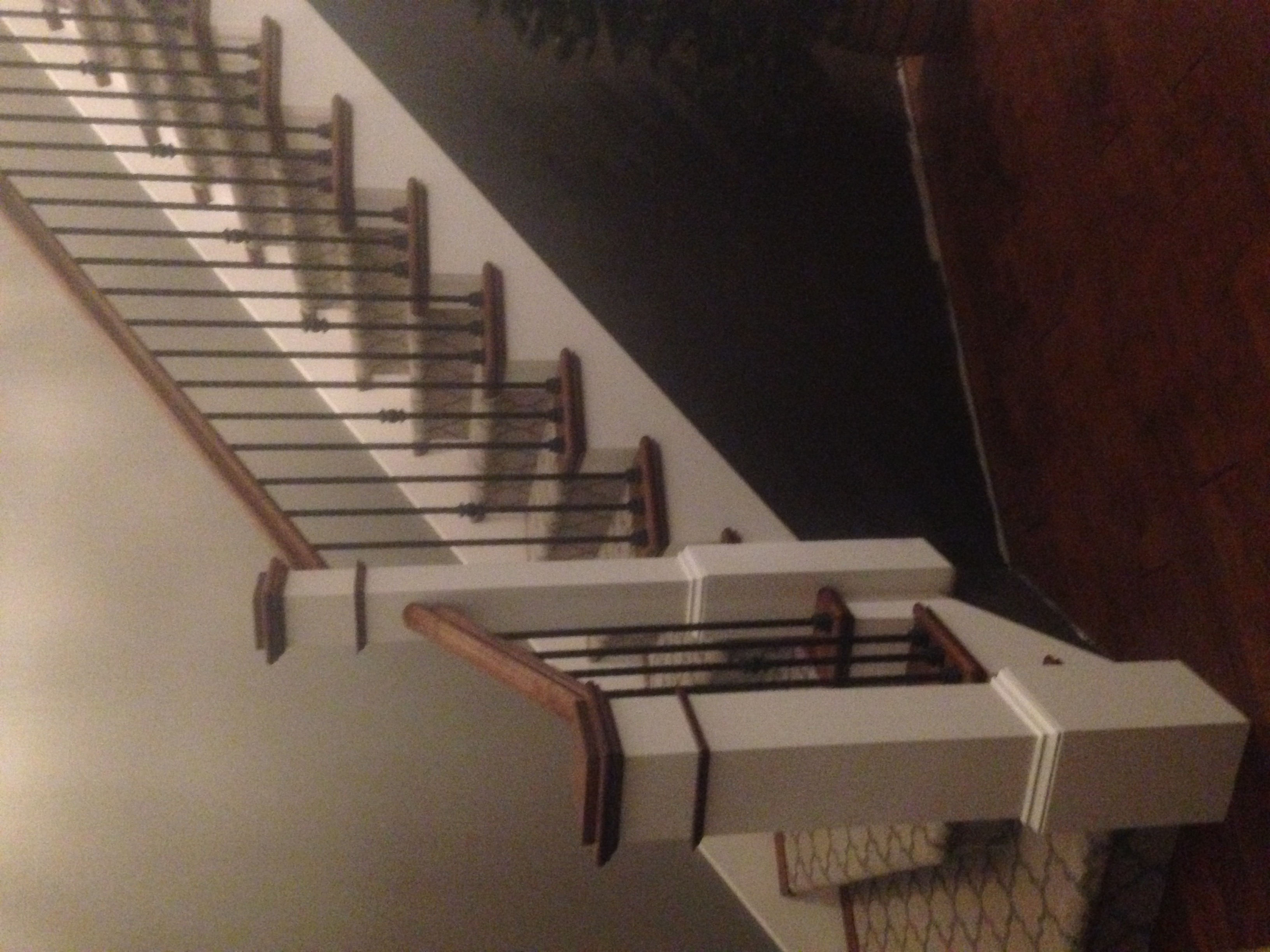 Wooden Staircase with White Banister