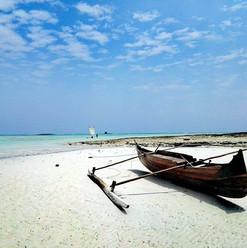 boat-spiaggia-sabbia-fine-bianca-corail-