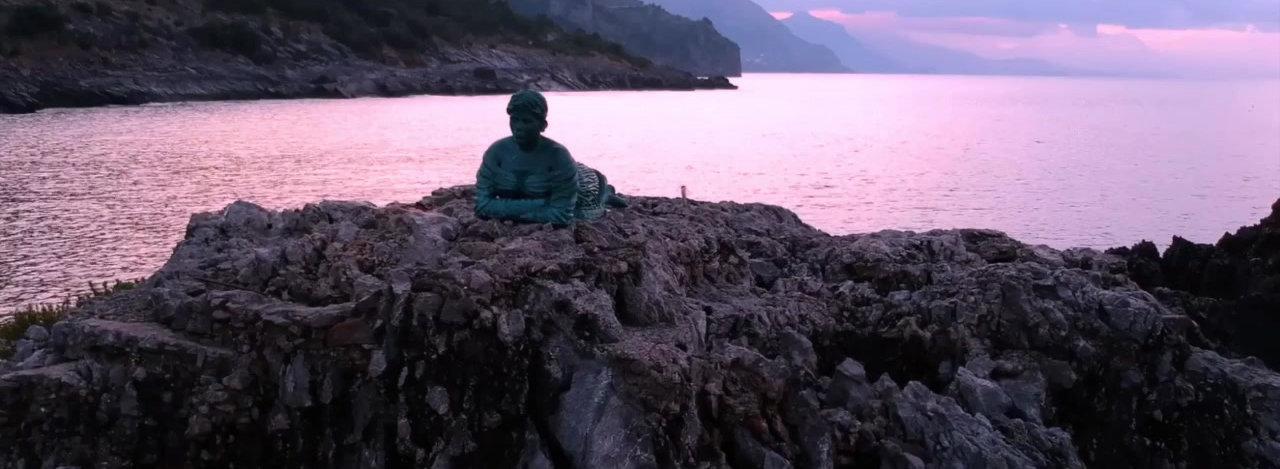 Scoglio dello Scialandro con la Statua della Spigolatrice di Sapri, Costa del Cilento all'alba...