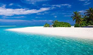 mare-turchese-limpido-spiaggia-sabbia-fi