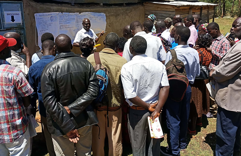 Farmers attending training at Engoho Kuku Farm being trainined on the importance of poultry farming