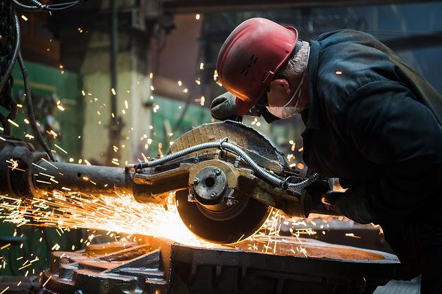 worker-grinding-metal-metal-grinding-mac