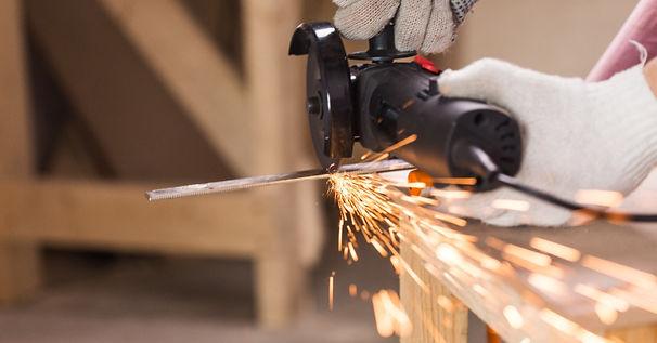 worker-cutting-steel.jpeg