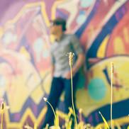 Man on a graffiti wall