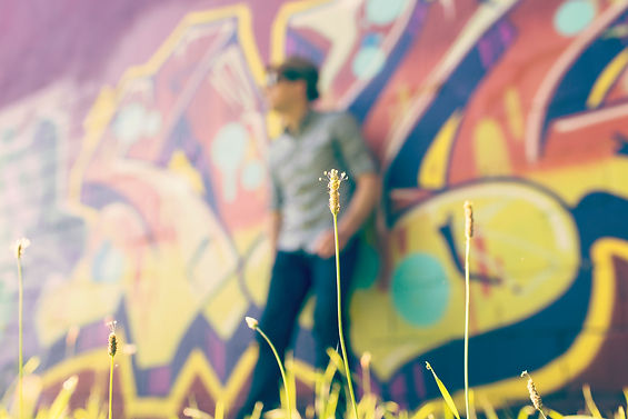 Man on a graffiti wall
