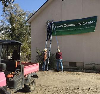 Putting up SCC banner.JPG