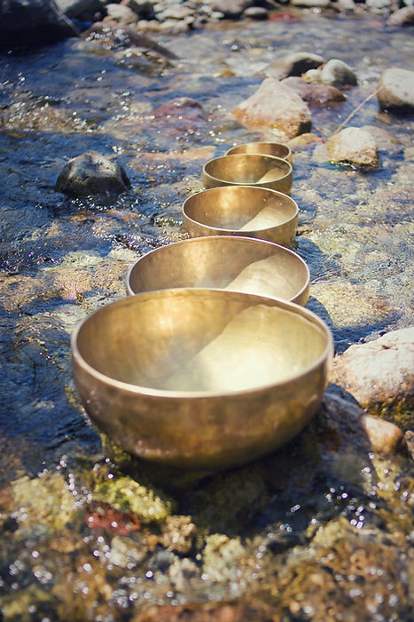 Tibetan Singing Bowls into the river. Me