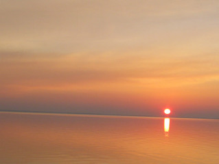 Sun rising up from Bon Secour Bay