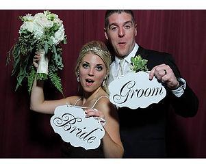 Bride & Groom Having Fun in Booth