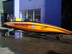 Lowe Orange Race Boat.JPG