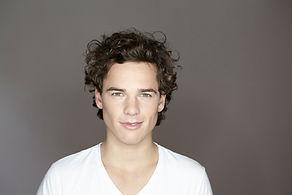 Headshot of Man Wearing a White
