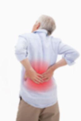Portrait of a man having a back pain aga