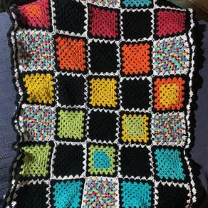 Rainbow Scrappy Granny Square Blanket
