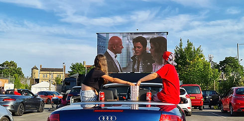 Kids with popcorn in convertable & scree