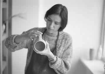 Female Potter Making Mug_edited.jpg