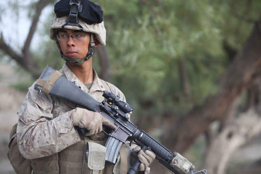 Marine provide security during patrol