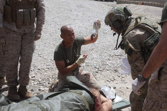 Corpsman treats wounded man